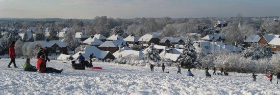 Children sledging in the snow on Bonfire Hill.