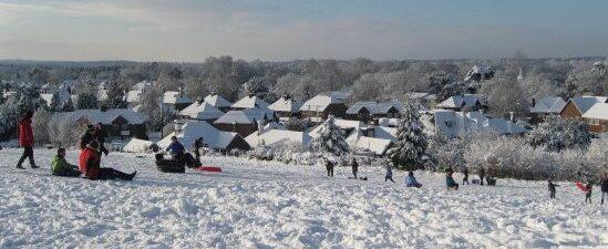 Children sledging in the snow on Bonfire Hill.