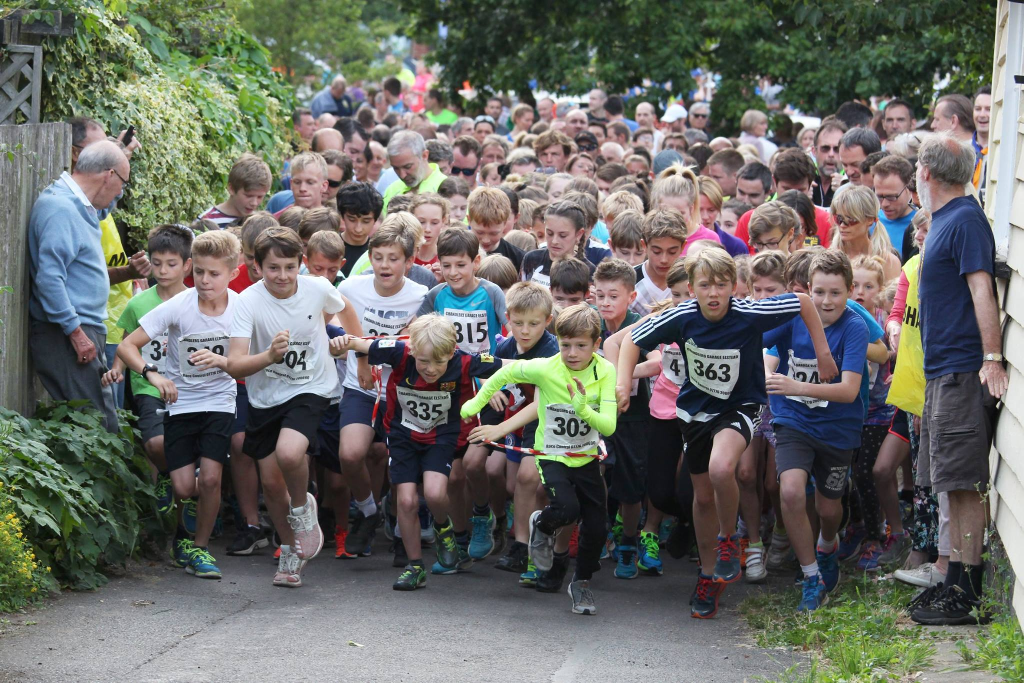 Lots of children starting the Elstead Marathon, with numbers on their shirts and keen to go.