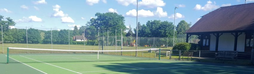 Elstead Tennis Courts and pavilion on a sunny day.