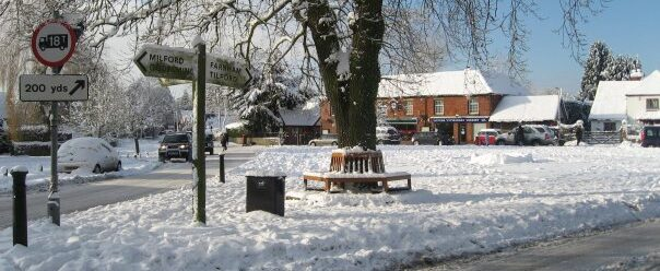 Village green covered with snow.